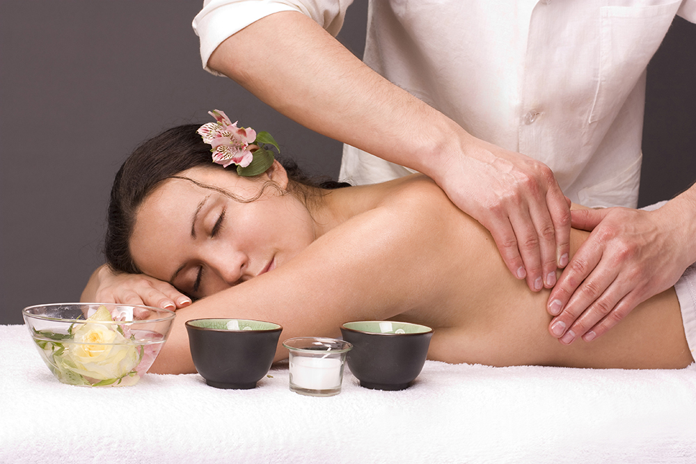 Woman having massage in the spa salon